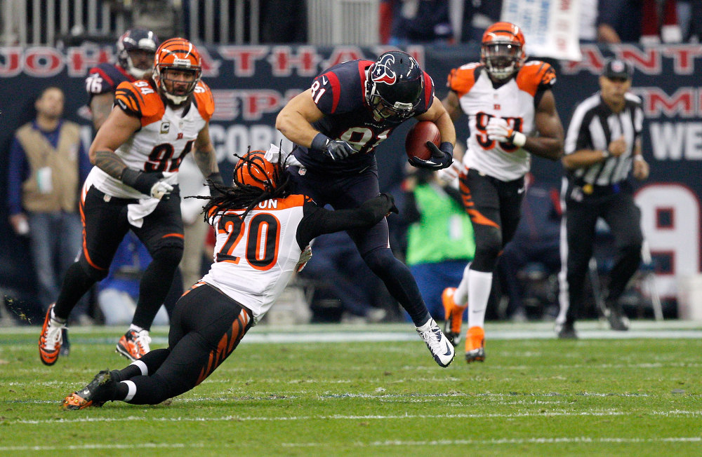 . Owen Daniels #81 of the Houston Texans attempts to run for yards after the catch in the first half against Reggie Nelson #20 of the Cincinnati Bengals during their AFC Wild Card Playoff Game at Reliant Stadium on January 5, 2013 in Houston, Texas.  (Photo by Bob Levey/Getty Images)