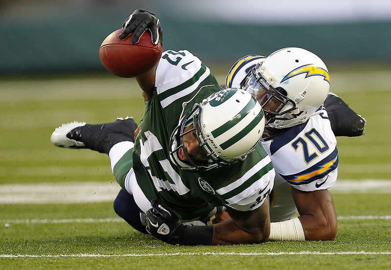 . Wide receiver Braylon Edwards #17 of the New York Jets is tackled by Antoine Cason #20 of the San Diego Chargers during the second half at MetLife Stadium on December 23, 2012 in East Rutherford, New Jersey. The Chargers defeated the Jets 27-17. (Photo by Rich Schultz /Getty Images)