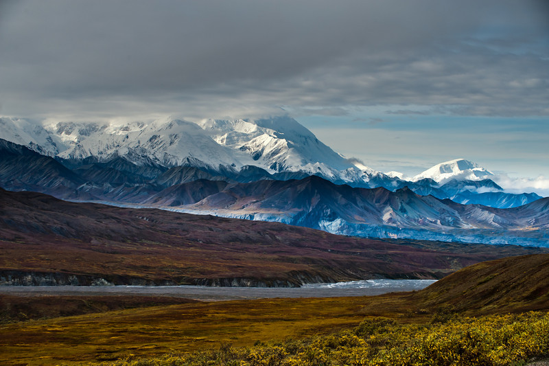 View of Mt McKinley and St Peters Peak (on the right and further away) from the Eielson Visitor Center, 66 miles inside the park. The light was fantastic. St Peters Peak is 10,600 feet high, the South Peak of Mt McKinley is 20,320 feet high.