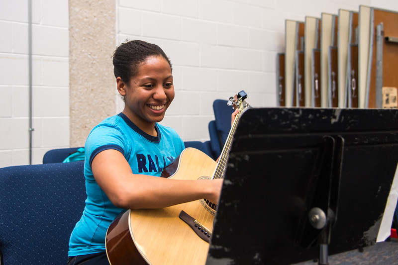 Student Bianca Garcia practices a musical piece during her Basic Guitar class.