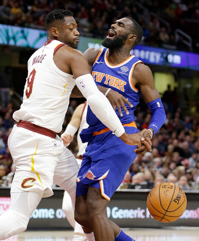 . Cleveland Cavaliers\' Dwyane Wade, left, fouls New York Knicks\' Tim Hardaway Jr. in the second half of an NBA basketball game, Sunday, Oct. 29, 2017, in Cleveland. The Knicks won 114-95. (AP Photo/Tony Dejak)