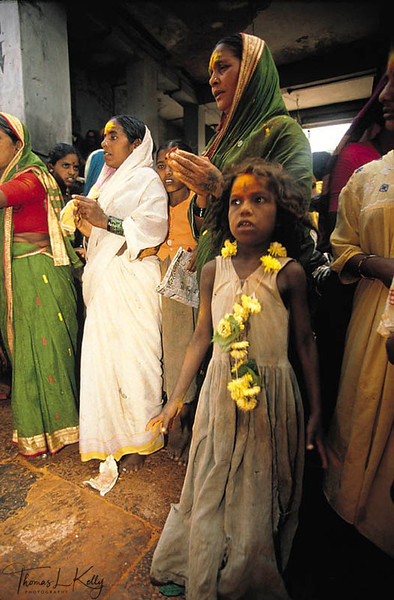 A terrified child, about  to be dedicated to the Goddess. Each year, an estimated 3,000 young girls are brought  to the festival of Yellama to be dedicated as Devadasis, or `handmaidens  of the Goddess. Saundatti, Karnataka, India.