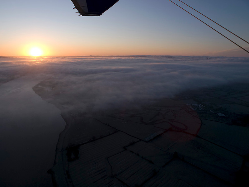 Sunrise as we headed out down river. Stunning watching from above the clouds. Olympus E3, 12-60mm SWD