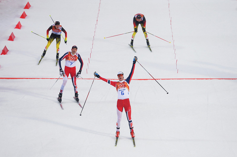 . Norway celebrates as he crosses the line to win the gold medal ahead of Magnus Hovdal Moan of Norway in the Nordic Combined Men\'s 10km Cross Country during day 11 of the Sochi 2014 Winter Olympics at RusSki Gorki Nordic Combined Skiing Stadium on February 18, 2014 in Sochi, Russia.  (Photo by Lars Baron/Getty Images)