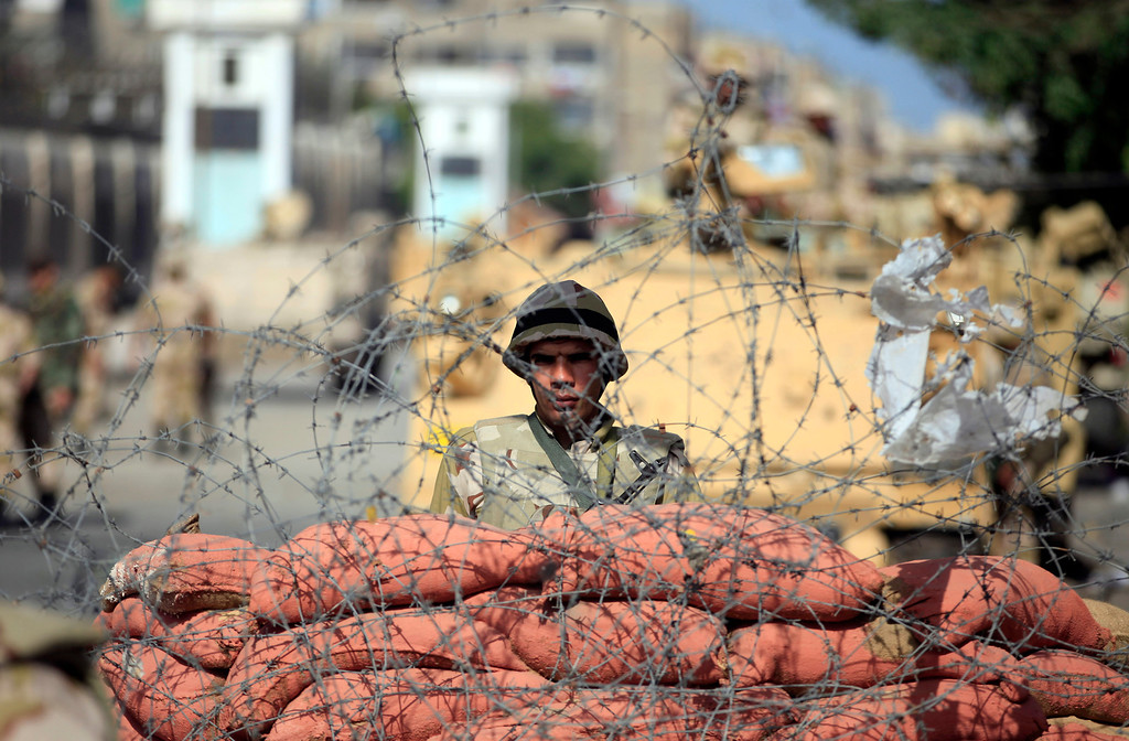 . An Egyptian soldier stands guard outside the prison in Port Said, Egypt, Saturday, March 9, 2013. (AP Photo/Khalil Hamra)