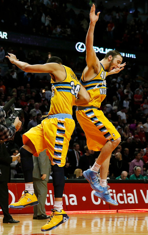 . Denver Nuggets\' JaVale McGee (L) and his teammate Kosta Koufos celebrate their win over the Chicago Bulls in their NBA basketball game in Chicago, Illinois, March 18, 2013.   REUTERS/Jim Young