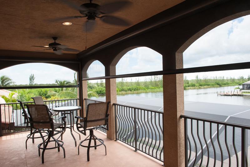 2nd Floor Balcony with Retractable Screens partway deployed