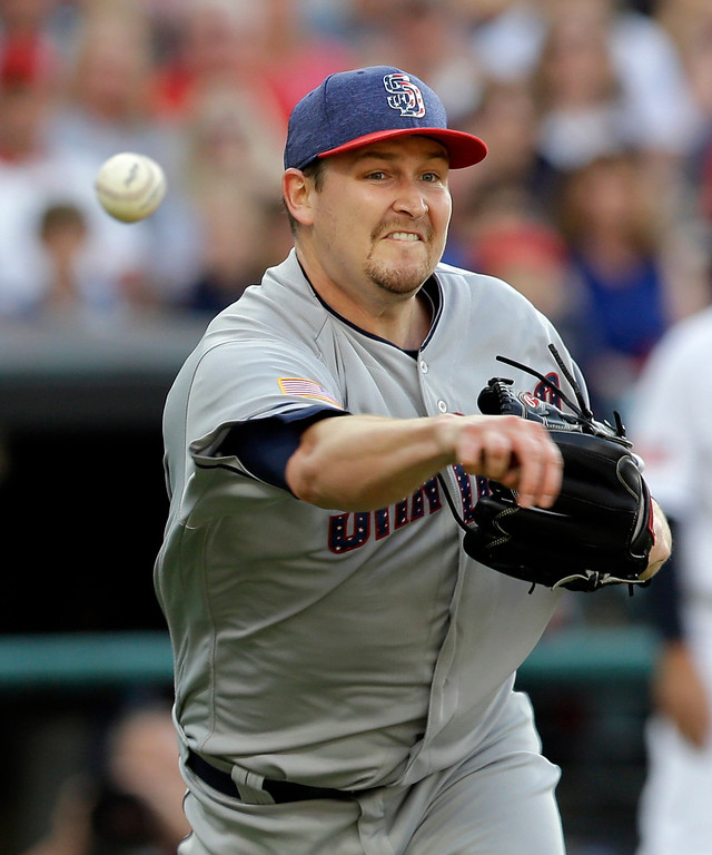 . San Diego Padres starting pitcher Trevor Cahill throws to first base to get Cleveland Indians\' Lonnie Chisenhall in the second inning of a baseball game, Tuesday, July 4, 2017, in Cleveland. Chisenhall was out on the play. (AP Photo/Tony Dejak)