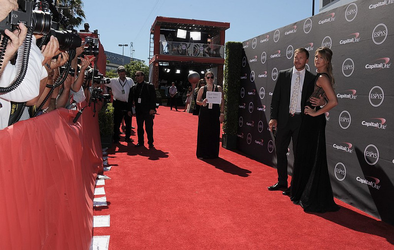 . Alpine ski racer Bode Miller, second from right, and Morgan Miller arrive at the ESPY Awards on Wednesday, July 17, 2013, at the Nokia Theater in Los Angeles. (Photo by Jordan Strauss/Invision/AP)