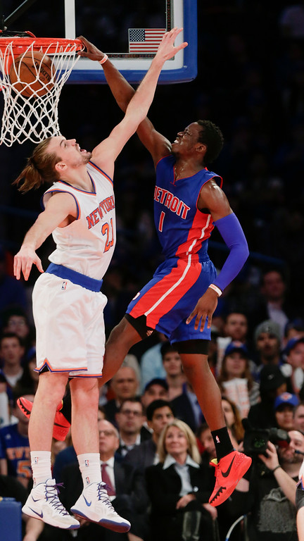 . Detroit Pistons\' Reggie Jackson (1) dunks against New York Knicks\' Lou Amundson (21) during the second half of an NBA basketball game Wednesday, April 15, 2015, in New York. The Pistons won 112-90. (AP Photo/Frank Franklin II)