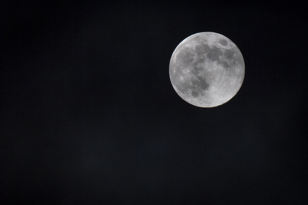 South Bay Moon 8/1/12. Captured with a Canon 7d, 70-200 and 2x extender, F5.6 1/30 second.