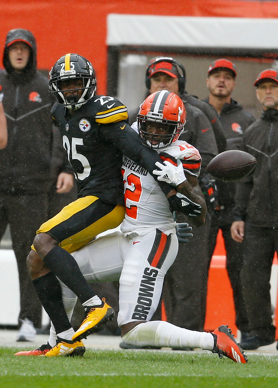 . Cleveland Browns wide receiver Josh Gordon (12) can\'t get to the ball as Pittsburgh Steelers cornerback Artie Burns (25) defends during the second half of an NFL football game, Sunday, Sept. 9, 2018, in Cleveland. Pass interference was called on Burns. (AP Photo/Ron Schwane)