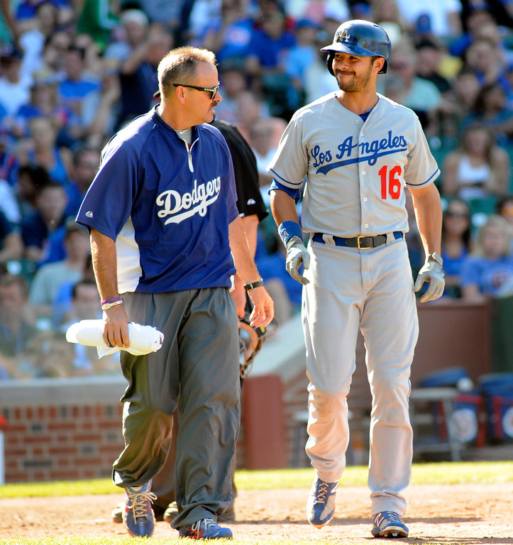 . Los Angeles Dodgers\' Andre Either reacts after being struck by a pitch in a baseball game against Chicago Cubs, Sunday, Aug. 4, 2013, in Chicago. (AP Photo/Joe Raymond)