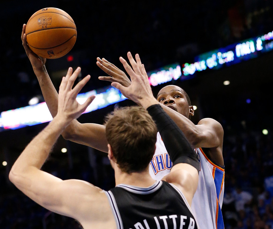 . Oklahoma City Thunder forward Kevin Durant (35) shoots over San Antonio Spurs center Tiago Splitter (22) in the second quarter of Game 3 of an NBA basketball playoff series in the Western Conference finals, Sunday, May 25, 2014, in Oklahoma City. (AP Photo/Sue Ogrocki)