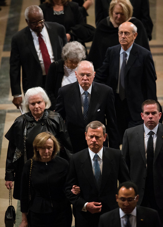 . Members of the Supreme Court, led by Chief Justice John G. Roberts, lower center, depart the funeral mass for the late Supreme Court Associate Justice Antonin Scalia, at the Basilica of the National Shrine of the Immaculate Conception in Washington, Saturday, Feb. 20, 2016.  Also shown are Justice Anthony M. Kennedy, center,  Justice Stephen G. Breyer, upper right, and Justice Clarence Thomas, upper left.  (Doug Mills/The New York Times via AP, Pool)