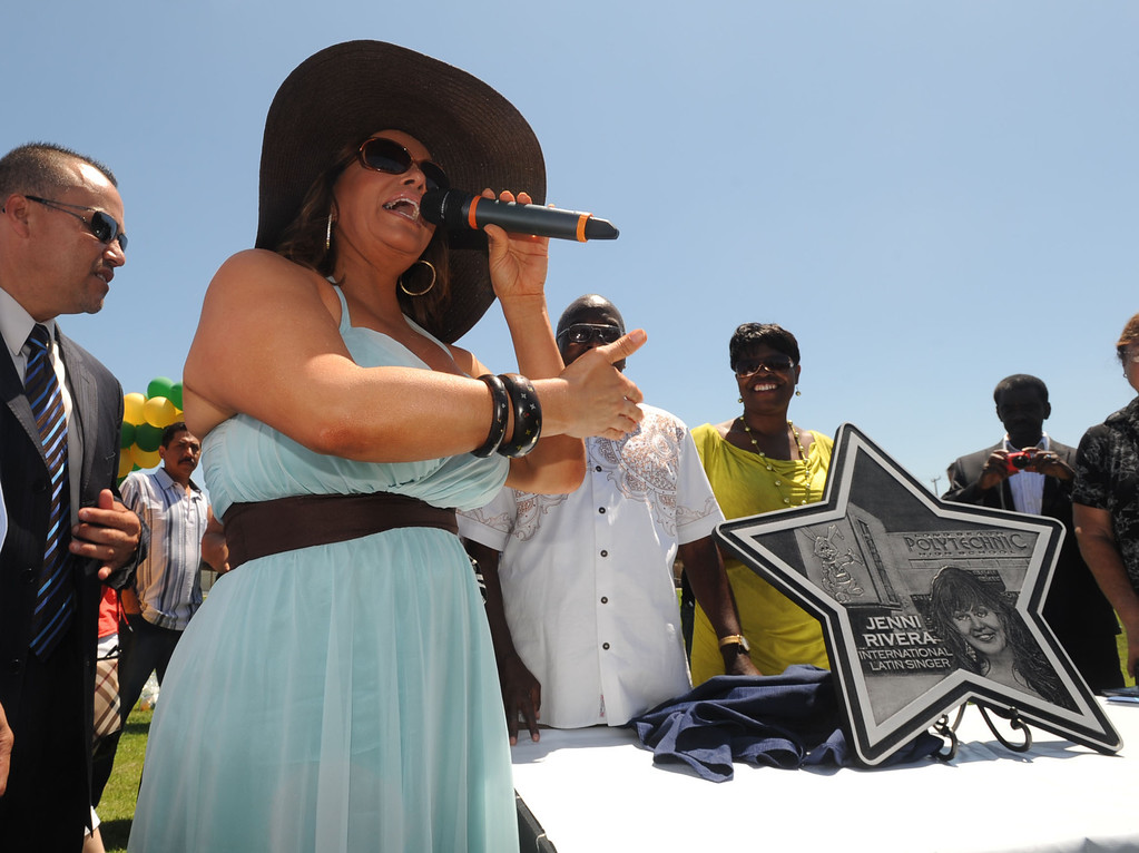 ". Long Beach Poly alum Jenni Rivera was honored Tuesday with a star on the Poly Walk of Fame. Rivera is internationally famous in the Latin music scene and also stars in her own reality television show.  The ""star\"" plaque is presented to Rivera..July 26, 2011..Photo by Steve McCrank / Daily Breeze"