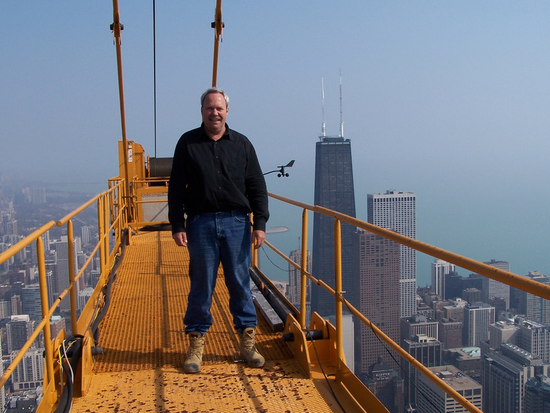 During his 30-year career as a heavy equipment operator, Ken Derry has developed a unique perspective on the city of Chicago. From the famous Deep Tunnel project 300 feet below ground to a perch atop the city's highest tower crane, Ken has viewed a Chicago that the rest of us will never see. While working on one of the city's tallest skyscrapers, Ken began to photograph the city as he saw it,  from the center of Chicago's Loop, and over 1300 feet in the air. He witnessed and photographed spectacular sunrises over Lake Michigan, special events like the Air and Water Show, and the everyday workings of this great city. Ken is passionate about taking photographs and loves to share his work with others.