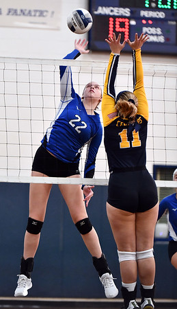 11/16/2019 Mike Orazzi | StaffrBristol Easterns Hannah Webber (22) Woodstock Academy's PKatherine Papp (11) during the 2019 State Girls Volleyball Tournament Class L Quarterfinals at BEHS in Bristol Saturday.