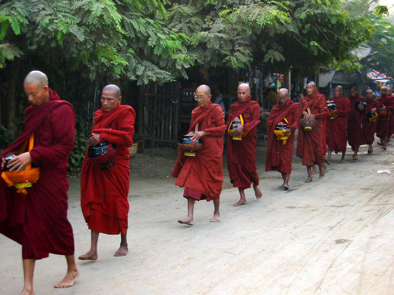 Buddist monks coming for alms