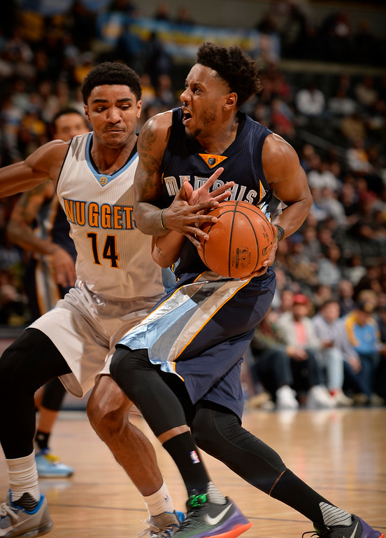 . DENVER, CO - FEBRUARY 29: Denver Nuggets guard Gary Harris (14) sticks his hand in on Memphis Grizzlies guard Mario Chalmers (6) as he drives to the basket during th fourth quarter February 29, 2016 at Pepsi Center. (Photo By John Leyba/The Denver Post)