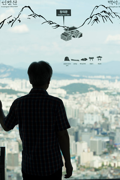 Silhouette of a person standing at window in observation tower, N Seoul Tower, Namsan Park, Namsan Mountain, Seoul, South Korea