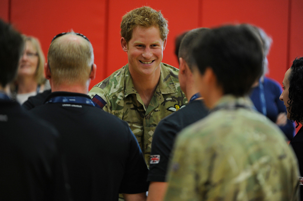 . COLORADO SPRINGS, CO - MAY 11: Britain\'s Prince Harry, center, greets British Armed Forces athletes at the United States Olympic Training Center before the 2013 Warrior Games Saturday morning, May 11th, 2013.  (Photo By Andy Cross/The Denver Post)