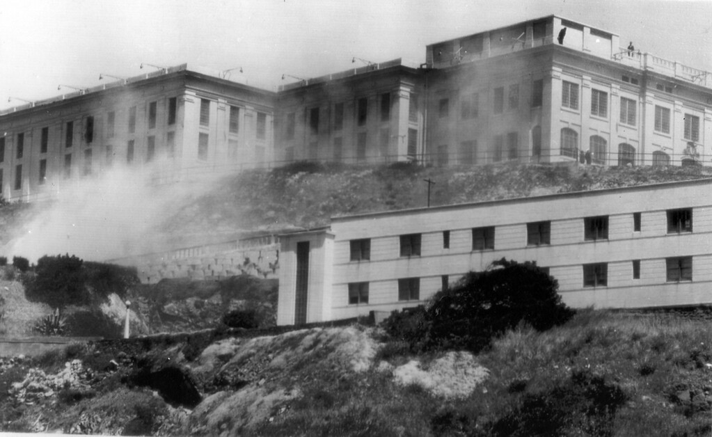 . Clouds of tear gas billows around Alcatraz on May 3, 1946 as prison guards and marines battle convicts in a riot. The gas was used along with rifle grenades.  (AP Photo/Tribune archives)