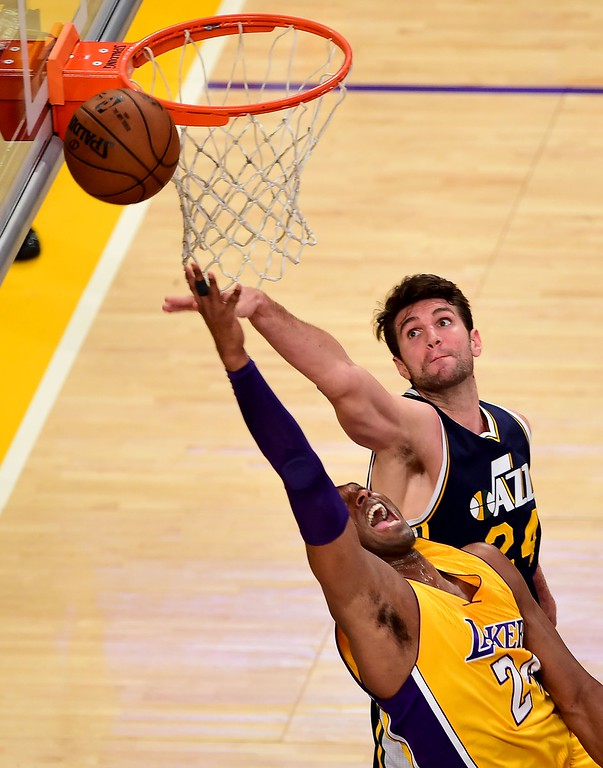 . Kobe Bryant of the Los Angeles Lakers shoots under pressure from Jeff Withey  of the Utah Jazz in their season-ending NBA western division matchup n Los Angeles, California on April 13, 2016. / AFP PHOTO / FREDERIC J. BROWNFREDERIC J. BROWN/AFP/Getty Images