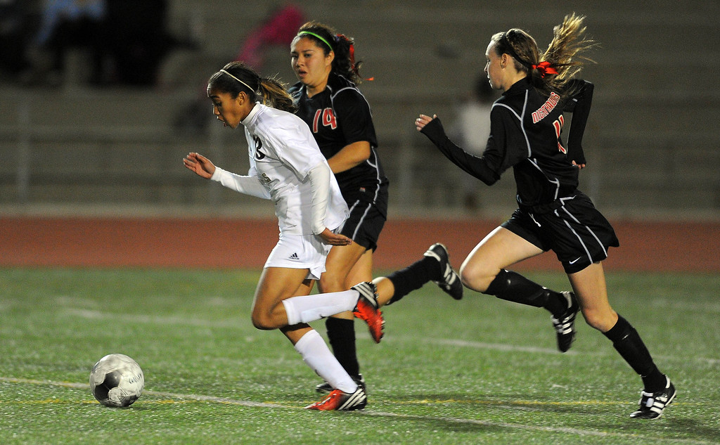 . TORRANCE - 02/12/2013 - (Staff Photo: Scott Varley/LANG) West High girls soccer beat Murrieta Valley on penalty kicks in their CIF Southern Section Division II wild-card matchup. After a 0-0 tie, West won 3-1 on PKs. West\'s Zoe Anderson takes off on a break as a pair of MV defenders chase her.