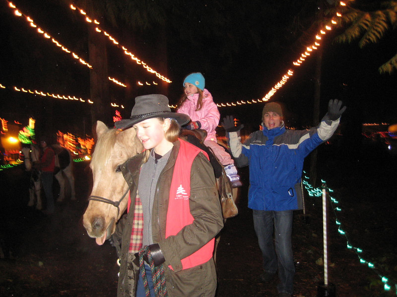 Seeing the Christmas Lights show at Warm Beach (Dec. '08) - The horse ride...and silly daddy.