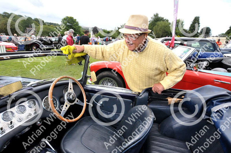 Skewen Motor Club Classic Car show.....annual classic car show... at Gnoll Park Terry Clark (ok) dusting down his son's 1961 Daimler Dart. BYLINE - www.adrianwhitephotography.co.uk