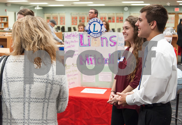 12/12/17 Wesley Bunnell | Staff The Berlin Upbeat Club held their 2017-18 Senior Expo on Tuesday evening at the high school. The expo featured Upbeat House Leaders discussing the focus of each house's activities. Jennifer Errico and Gabriel Ramsey of Lions and Mitchell House speak with visitors.