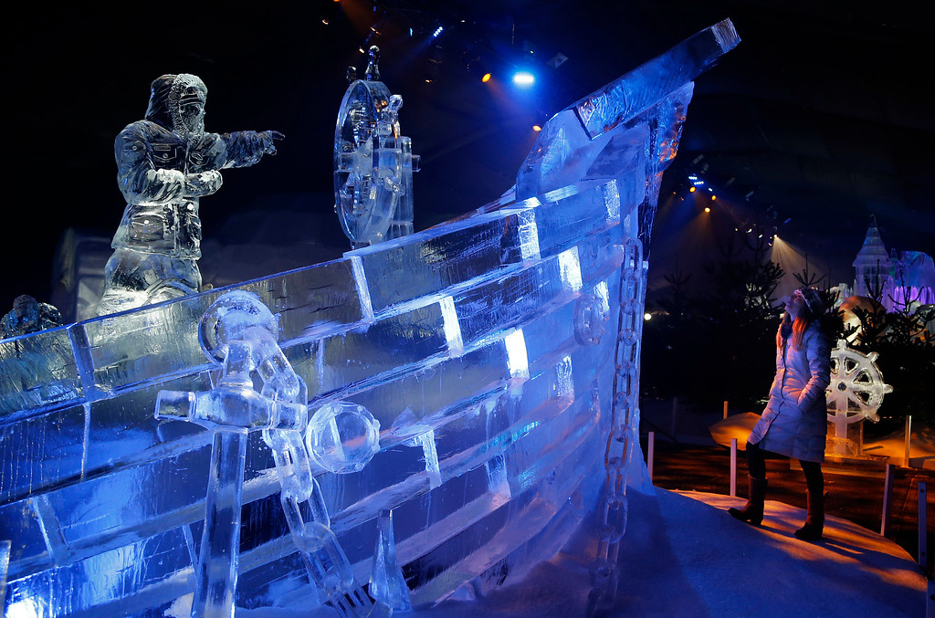 . A woman looks at the boat ice sculpture at the launch of Hyde Park Winter Wonderland\'s Magical Ice Kingdom in London, Thursday, Nov. 17, 2016. This years Winter Wonderland starts on November 18, 2016 and lasts until January 2, 2017. (AP Photo/Frank Augstein)
