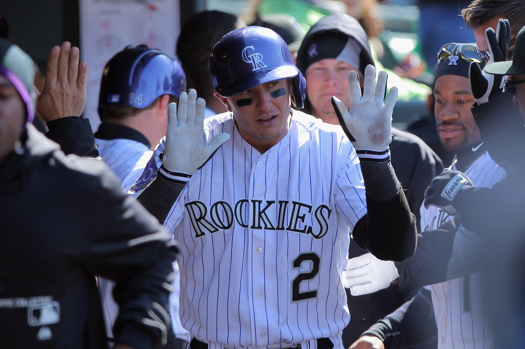 . Troy Tulowitzki #2 of the Colorado Rockies celebrates his solo homerun off of Jeremy Hefner #53 of the New York Mets in the eighth inning at Coors Field on April 18, 2013 in Denver, Colorado.  (Photo by Doug Pensinger/Getty Images)