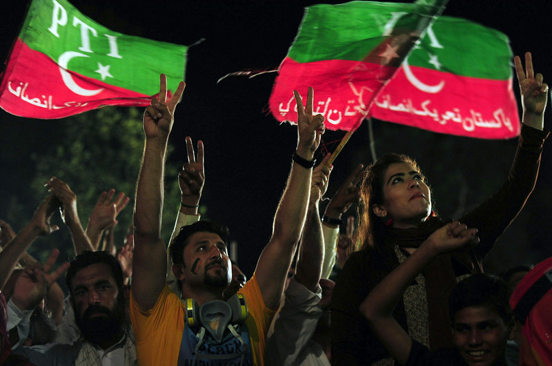 . Pakistani supporters of cricketer-turned politician Imran Khan listen to Khan\'s speech during an anti-government protest near the prime minister\'s residence in Islamabad on September 1, 2014. Hundreds of protesters trying to topple Pakistan\'s government briefly seized the state broadcaster on September 1, intensifying the political crisis gripping the nuclear-armed nation. Deadly clashes since the weekend have raised the spectre of military intervention which gained ground after one disillusioned opposition leader said the protesters were acting according to a plan devised by the army. ASIF HASSAN/AFP/Getty Images