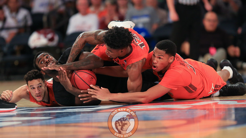 Virginia Tech's forward Kerry Blackshear Jr. (24), guard Ahmed Hill (13), guard Devin Wilson (11) and St. Louis' guard Jordan Goodwin (0) fight for a loose ball in Madison Square Garde, Nov. 16, 2017. St. Louis upset Virginia Tech with a 77-71 win.