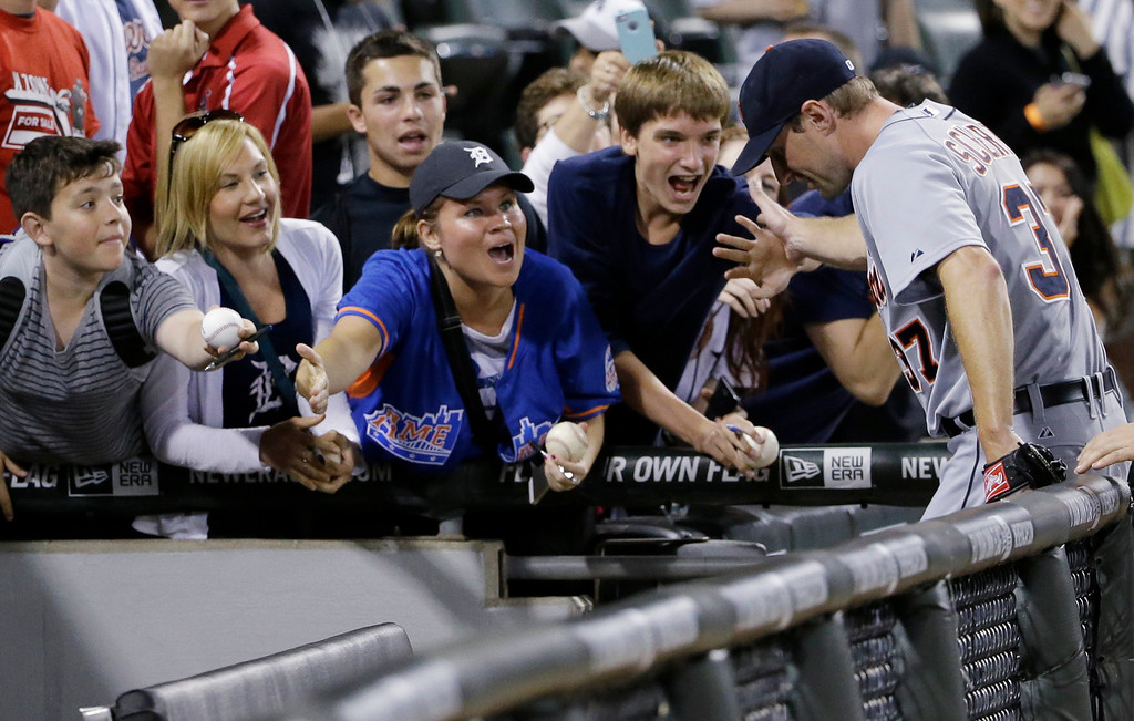 . Detroit Tigers starter Max Scherzer, right, celebrates with fans after the Tigers defeated the Chicago White Sox 4-0 in a baseball game in Chicago on Thursday, June 12, 2014. (AP Photo/Nam Y. Huh)