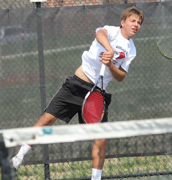 Roman Piftor serves in his singles match against Pfeiffer University.
