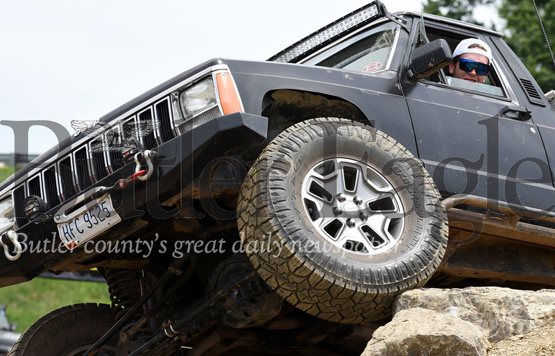 Harold Aughton/Butler Eagle: Jeep enthusiasts from New York take on the mud pit at the 9th Annual Bantham Jeep Heritage Festival Saturday, June 8.