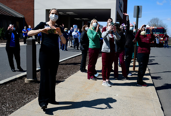 4/17/2020 Mike Orazzi | Staff The mutual salute in front of The Hospital of Central Connecticut in New Britain as a way to acknowledge the hard work and dedication of both medical staff and local first responders during the COVID-19 pandemic.
