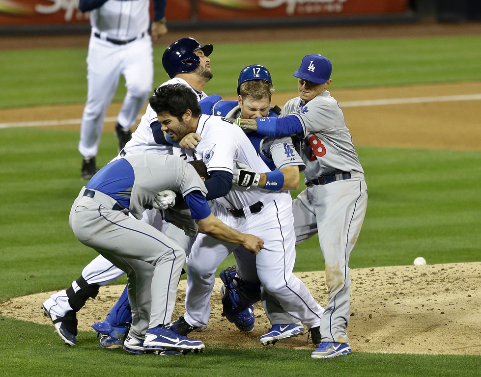 . San Diego Padres\' Carlos Quentin, center without hat,  charges into Los Angeles Dodgers  pitcher Zack Greinke, left foreground, after being hit by a pitch in the sixth inning of baseball game in San Diego, Thursday, April 11, 2013. (AP Photo/Lenny Ignelzi)