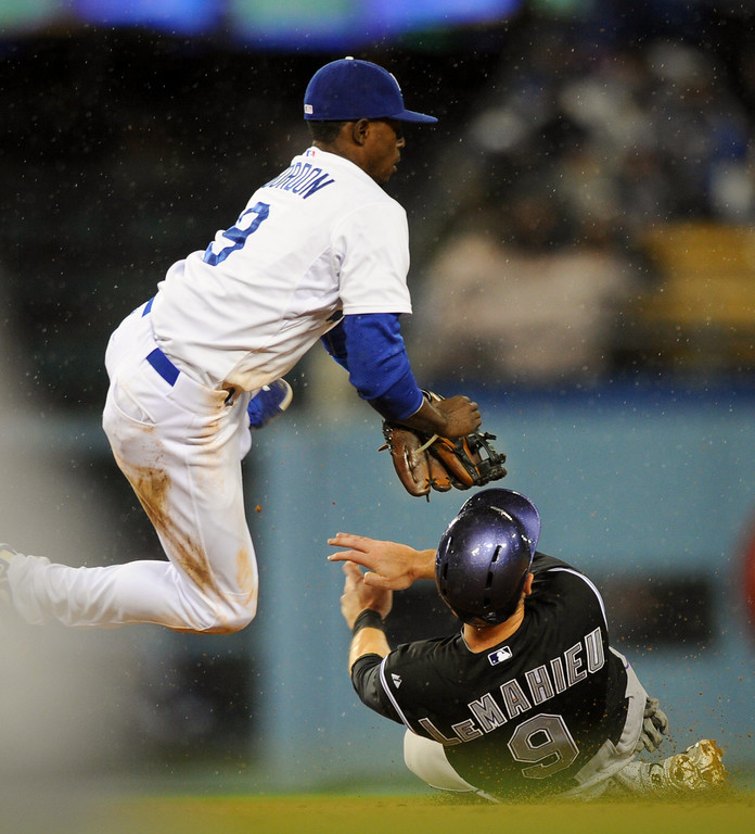 . Dodgers second baseman Dee Gordon collides with the Rockies\' DJ LeMahieu as LeMahieu steals second in the eighth inning, Friday, April 25, 2014, at Dodger Stadium. (Photo by Michael Owen Baker/L.A. Daily News)