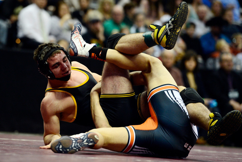 . DENVER, CO - FEBRUARY 23: 160-pounder T.J. Shelton of Meeker scrambles against Del Norte\'s Austin McDonald en route to winning 8-2 in the class 2A final during the Colorado State High School Wrestling Championships. The state\'s top wrestlers squared off in four classes in front of a near-capacity crowd at the Pepsi Center. (Photo by AAron Ontiveroz/The Denver Post)