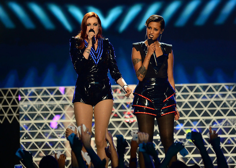 ". Singers Caroline Hjelt and Aino Jawo of ""Icona Pop\"" perform onstage during the 2013 Billboard Music Awards at the MGM Grand Garden Arena on May 19, 2013 in Las Vegas, Nevada.  (Photo by Ethan Miller/Getty Images)"
