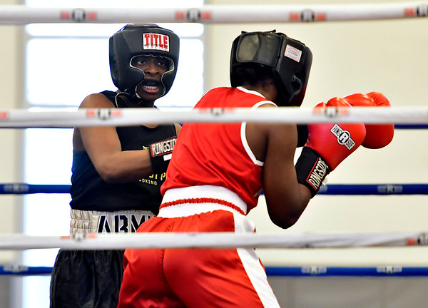 3/16/2019 Mike Orazzi | Staff West Points Ebakoliane Obiomon (blue) and Lock Haven Universitys Leah Hartzell in a 147 match during the National Collegiate Boxing Association National Qualifier held at the Bristol Boys & Girls Club in Bristol, Conn. on Saturday.