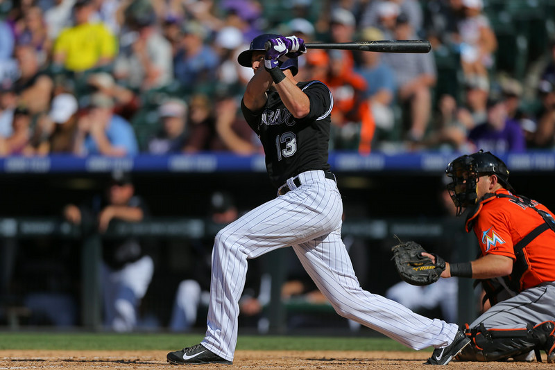 . Drew Stubbs #13 of the Colorado Rockies hits an RBI double during the sixth inning against the Miami Marlins at Coors Field on August 24, 2014 in Denver, Colorado. The Rockies defeated the Marlins 7-4. (Photo by Justin Edmonds/Getty Images)
