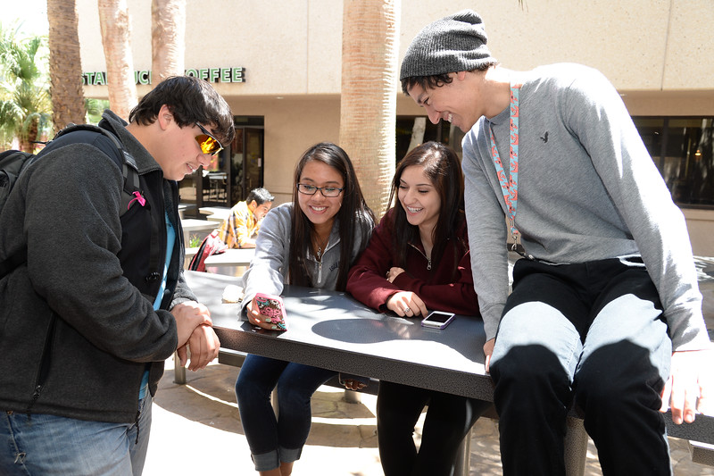 students-hang-out-between-classes-at-the-on-campus-starbucks-patio_13961091146_o.jpg