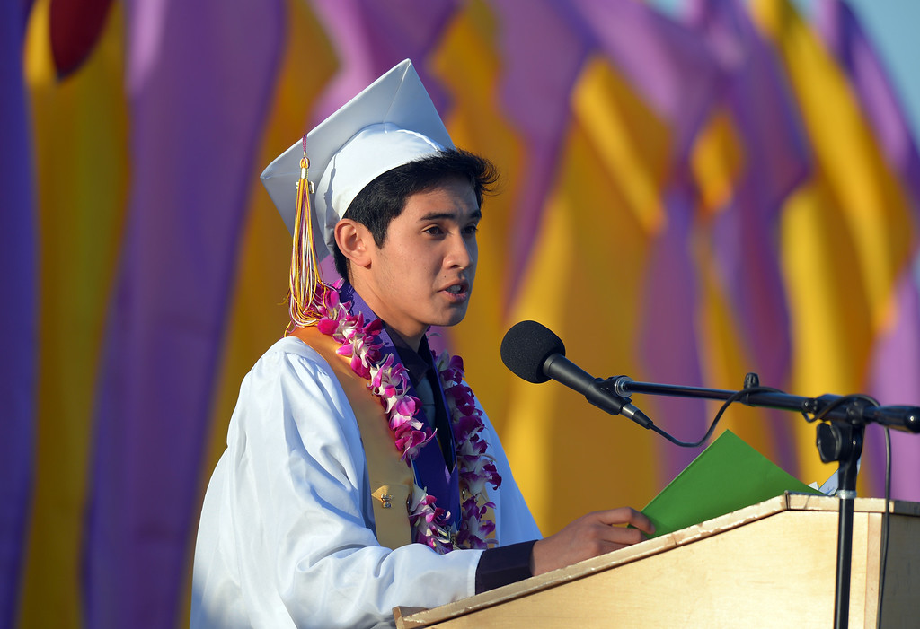 . Class valedictorian Jacob Hollman.  Norwalk High School\'s graduating class of 2014 goes through their commencement ceremony at Excelsior High School\' football stadium in Norwalk, CA on Tuesday, June 17, 2014. (Photo by Scott Varley, Daily Breeze)