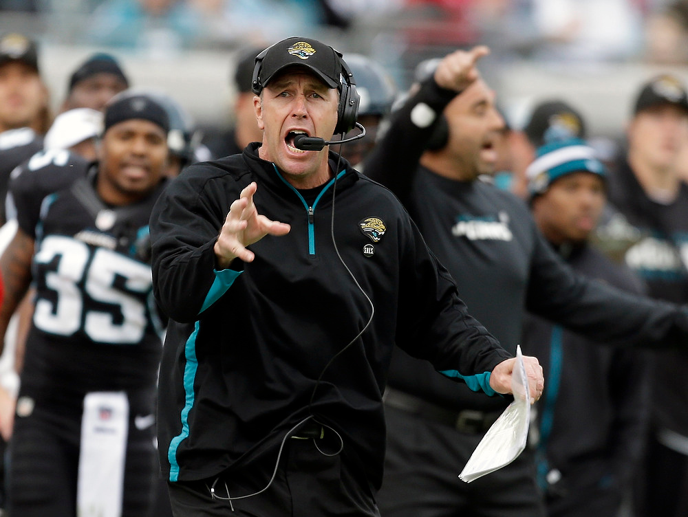 . Jacksonville Jaguars head coach Mike Mularkey yells for his team to spike the ball to stop the clock during the final seconds of an NFL football game against the New England Patriots, Sunday, Dec.  23, 2012, in Jacksonville, Fla. New England won the game 23-16. (AP Photo/John Raoux)