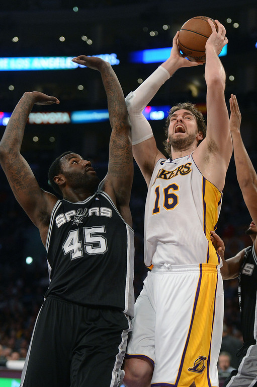 . The Lakers\'  Pau Gasol #16 looks to shoot as the Spurs\' DeJuan Blair #45 defends during game four of their NBA Western Conference playoffs at the Staples Center Saturday, April 28, 2013. The Spurs beat the Lakers 120-89. (Hans Gutknecht/Staff Photographer)